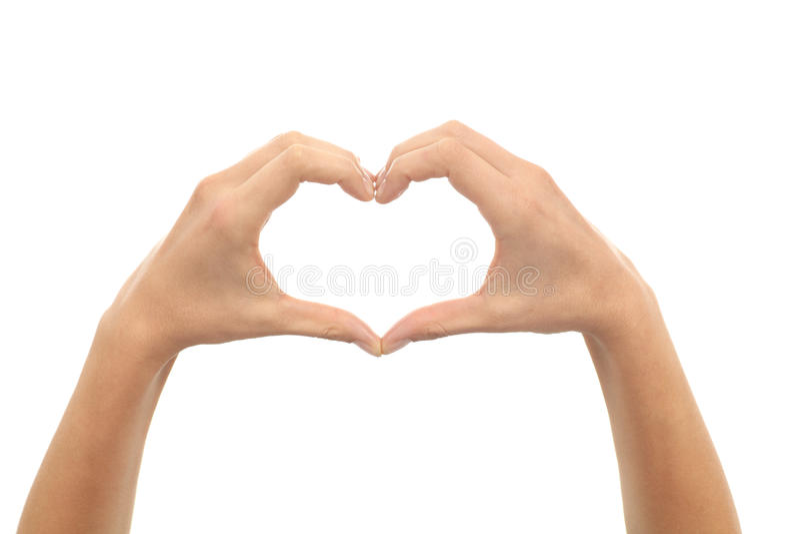 Mains de femme effectuant une forme de coeur photo libre de droits
