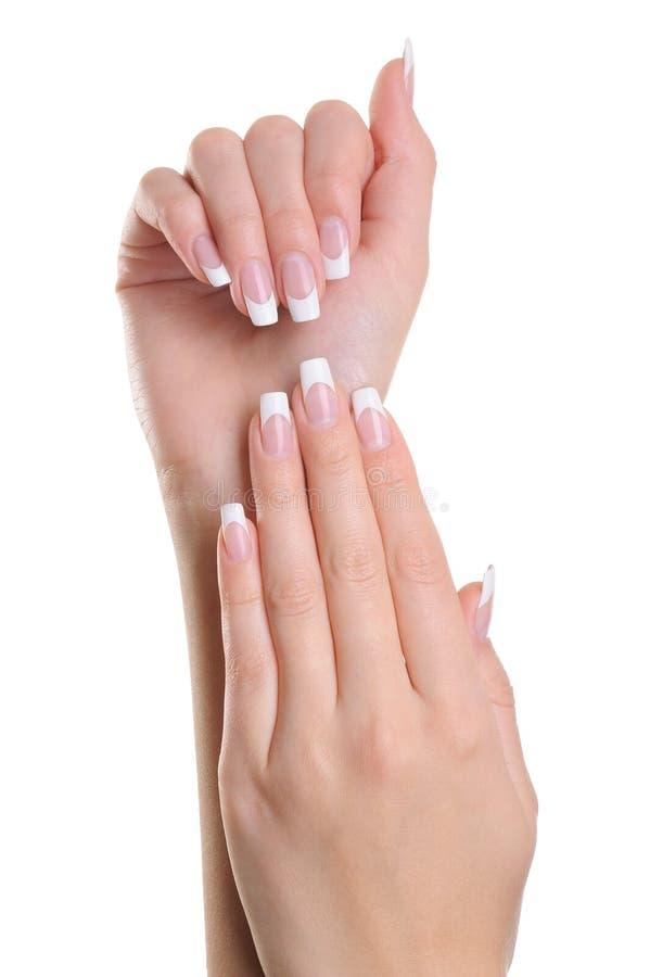 Mains de femmes avec la manucure de la France image libre de droits