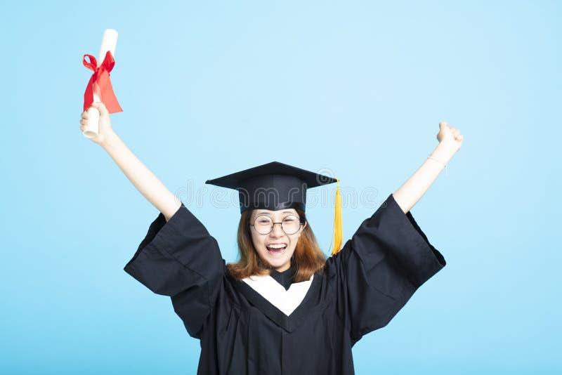 mains de fille d'obtention du diplôme de succès  image stock