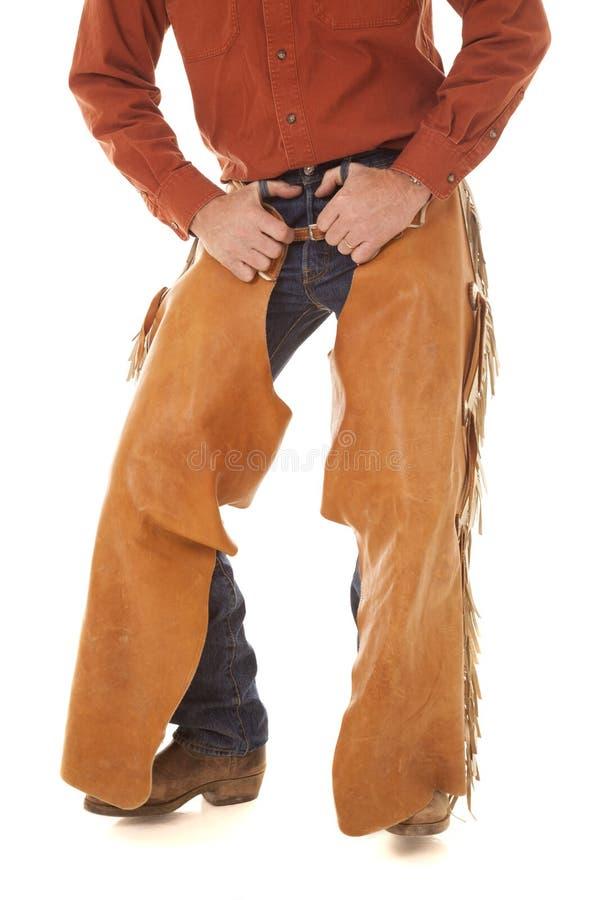 Mains de gerçures dans des boucles de ceinture photos libres de droits