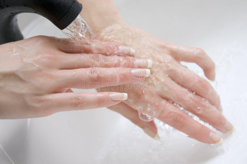 Mains de lavage images libres de droits