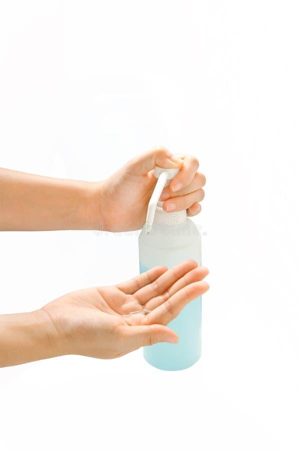 Mains de lavage avec du savon liquide images stock