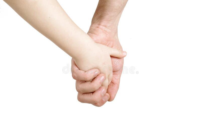 Mains de père et d'enfant photo libre de droits