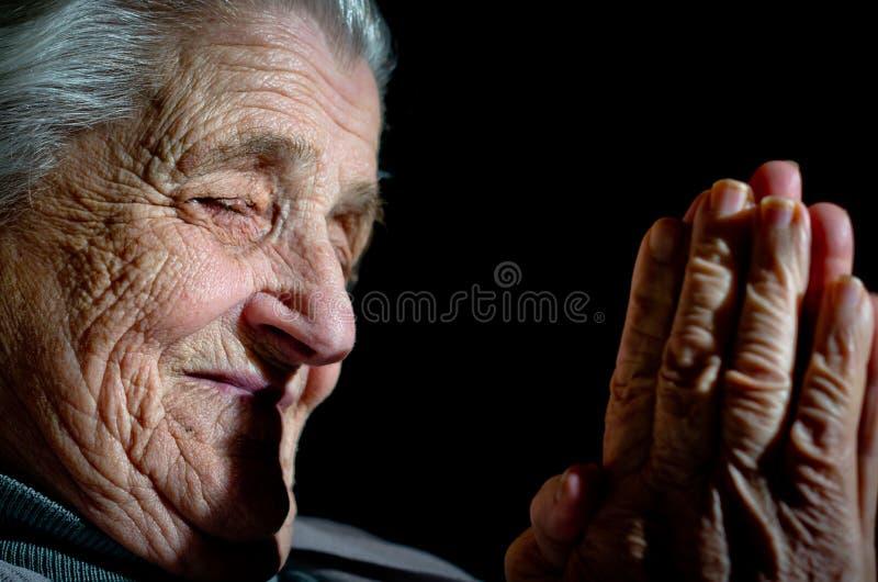 Mains de prière photo stock