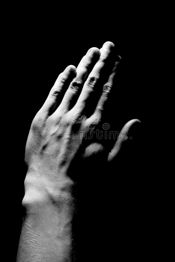 Mains de prière photographie stock