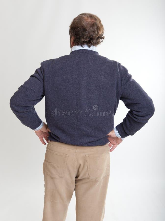 Mains de vue arrière d'homme sur des gratte-culs photographie stock