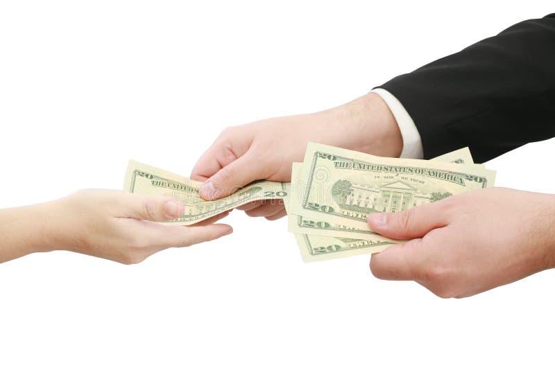 Mains donnant l'argent d'isolement photographie stock libre de droits