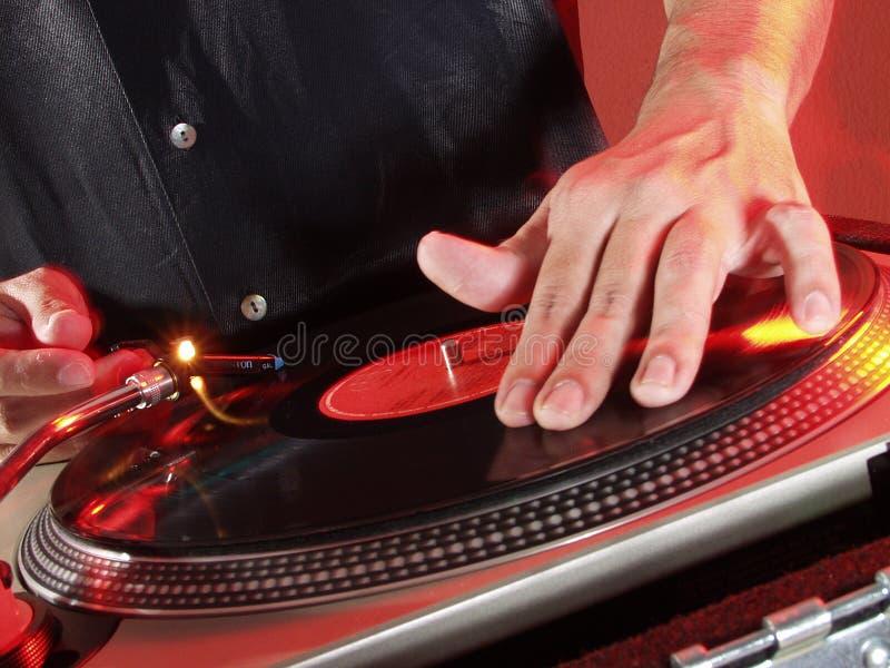 Mains du DJ. image libre de droits