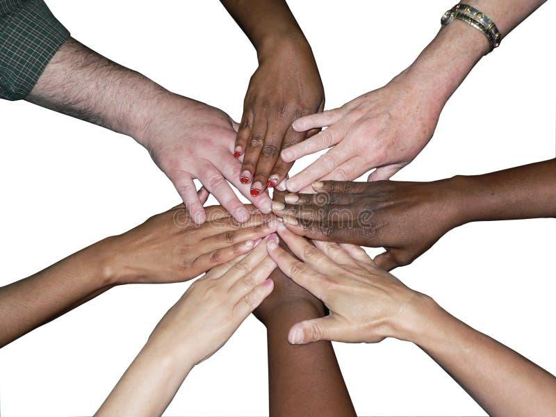 Mains empilées par équipe diverse images libres de droits