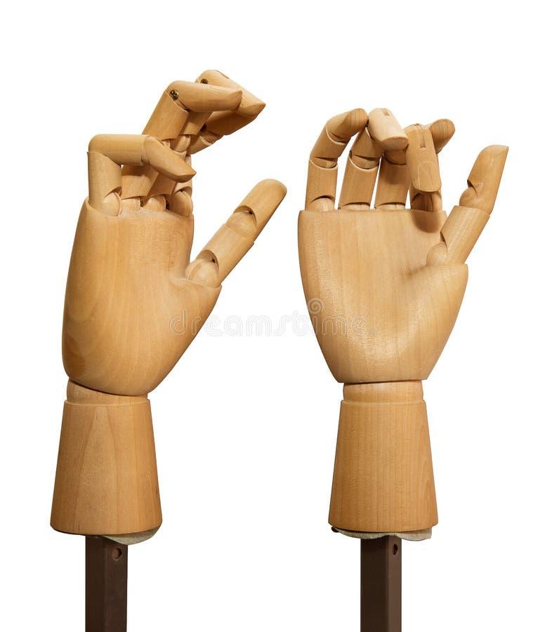 Mains en bois sur un fond blanc photographie stock