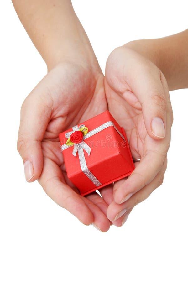 Download Mains et cadeau photo stock. Image du humain, anniversaire - 731052