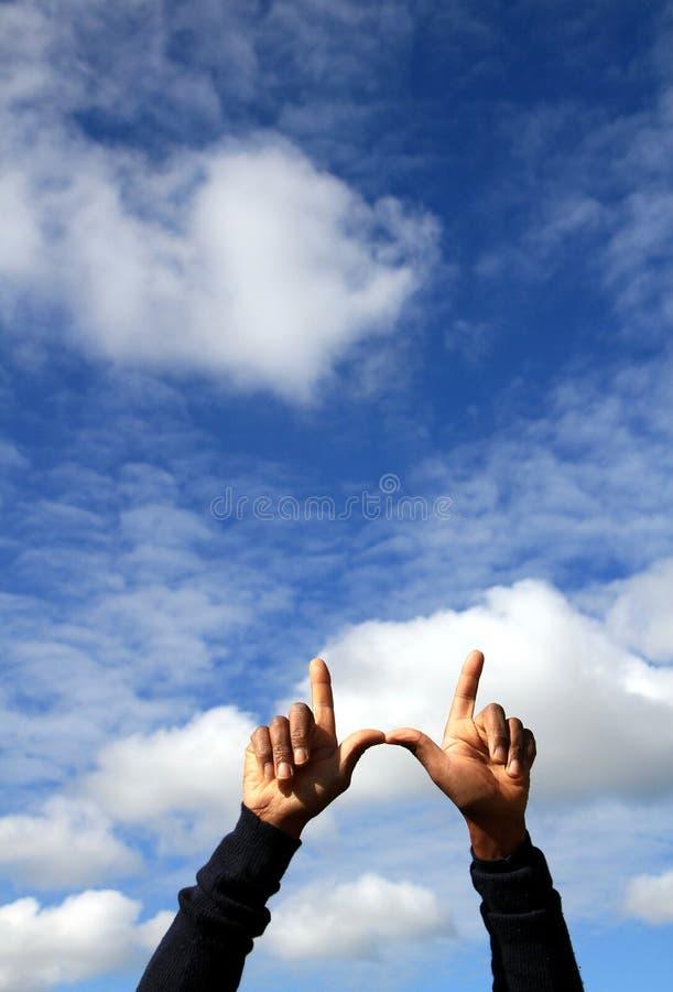 Mains et ciel photos libres de droits