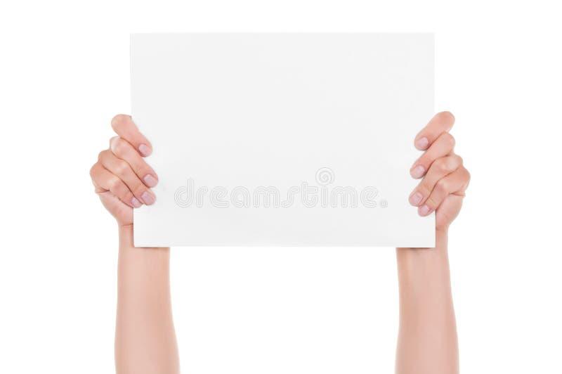 Mains et papier photo stock