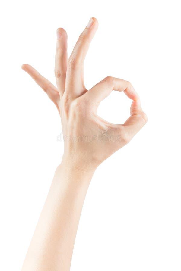 Mains femelles faisant l'OK de signe photos stock