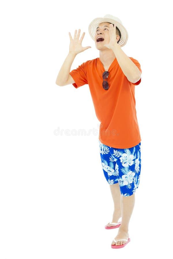 Mains heureuses d'augmenter de jeune homme à hurler photo libre de droits