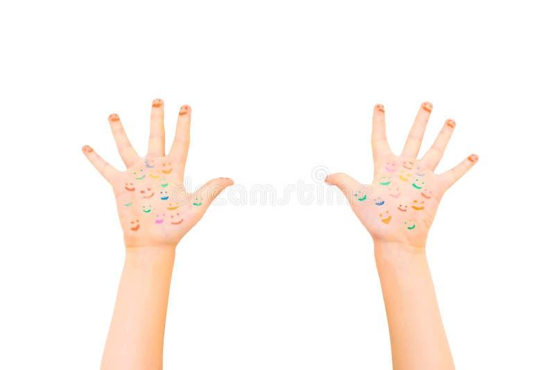 Mains heureuses de sourire de bébé Beaucoup de sourires sont reflètents sur les mains image stock