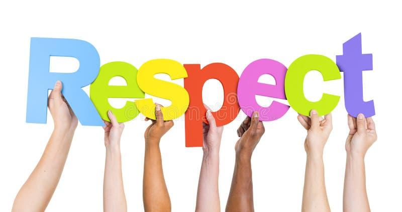 Mains humaines tenant le respect de Word photos libres de droits
