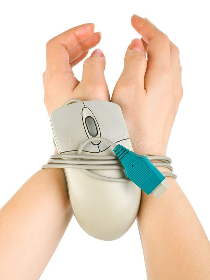 Mains liées par le câble de souris photo libre de droits