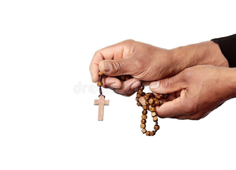 Mains priant avec la croix de perle de chapelet photo libre de droits