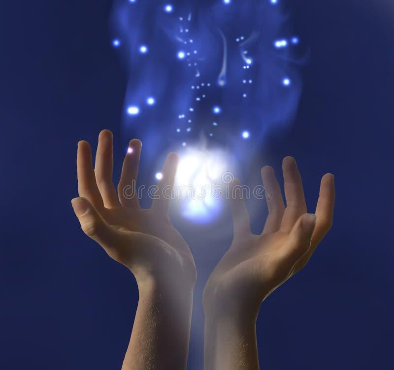 Mains retenant la lumière lumineuse illustration stock
