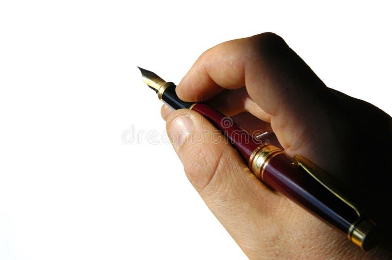Mains - stylo-plume image libre de droits