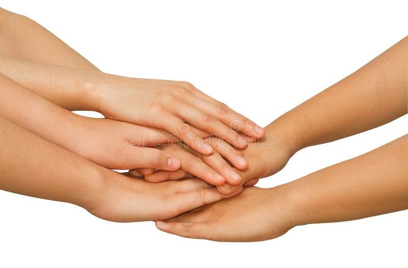 Mains sur l'un l'autre montrant l'unité photos libres de droits