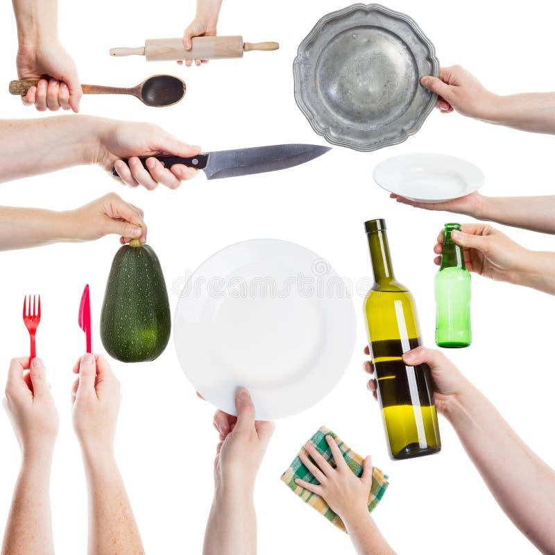 Mains tenant de divers ustensiles de cuisine photographie stock