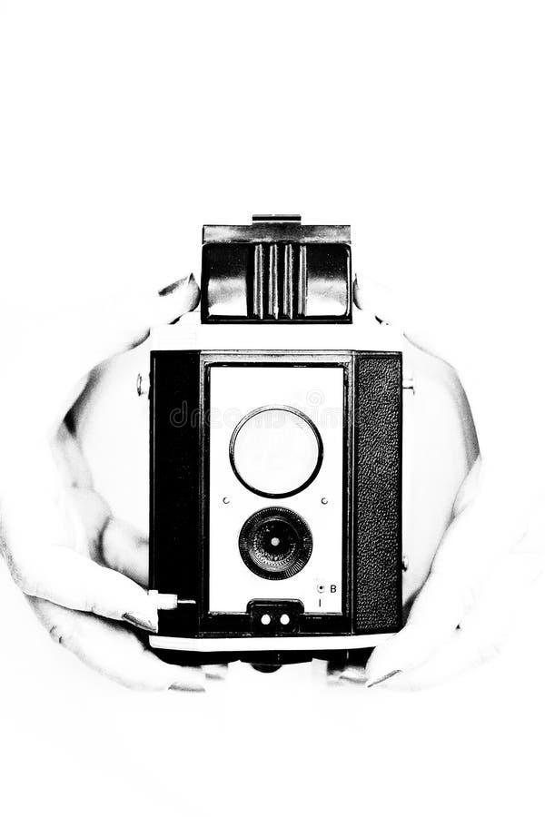 Mains tenant Kodak Brownie Reflex images libres de droits