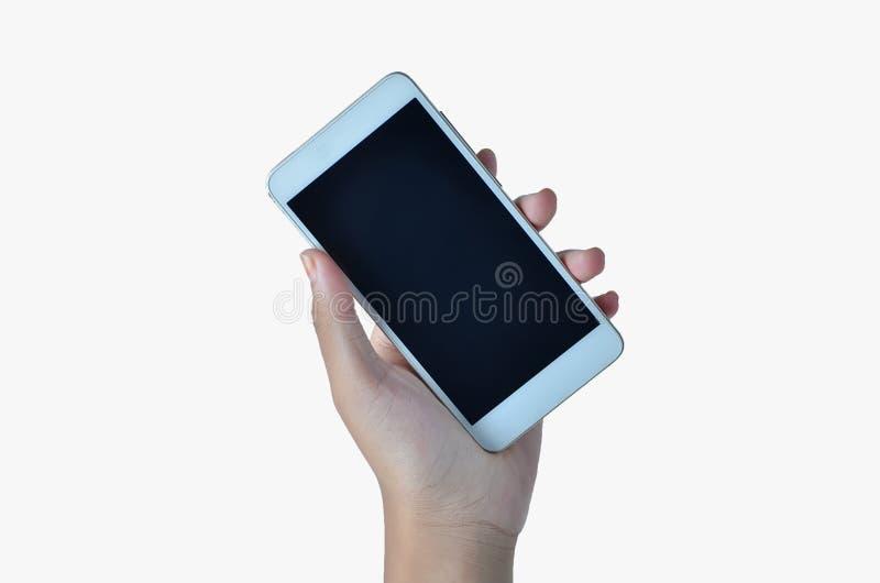 Mains tenant le t?l?phone photographie stock
