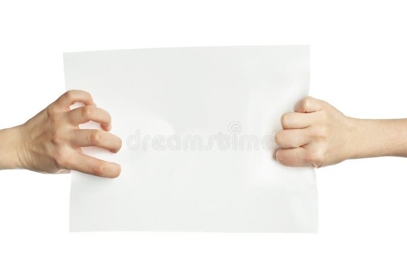 Mains tirant le papier blanc photographie stock