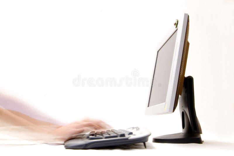 Mains très rapides sur le clavier photo stock