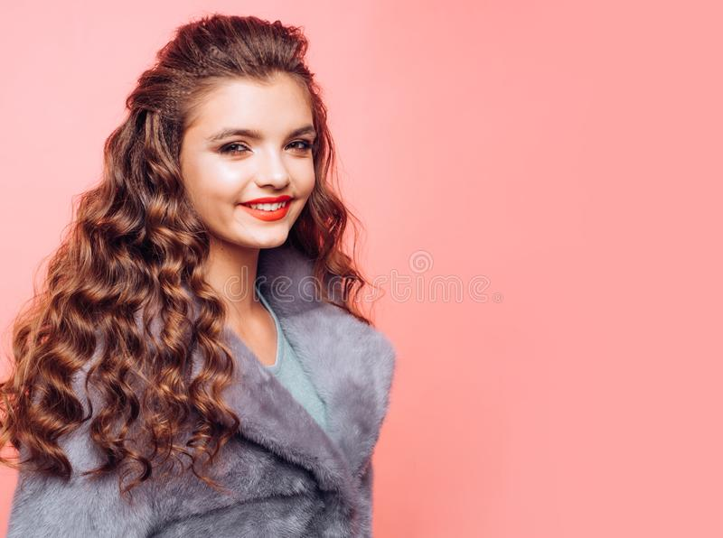 Maintaining natural volume. Pretty girl with curly hairstyle. Healthy hair care. Hair styling in hair salon. Young woman. With long locks of hair. Teenage girl royalty free stock photos