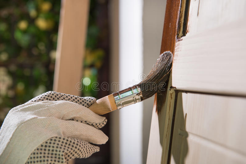 Maintaining of wooden surfaces stock photography