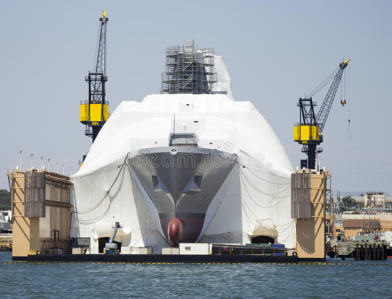 SAN DIEGO, CA - Construction on Navy vessel stock photo