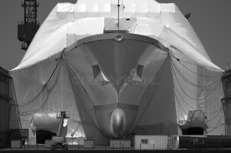 SAN DIEGO, CA - Construction on Navy vessel toned stock photos