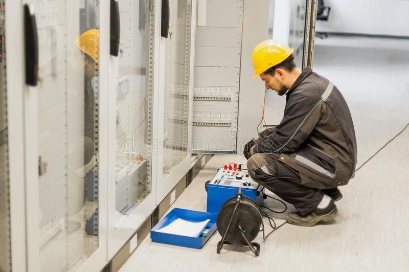 Maintenance engineer inspect system with relay test set equipment. Relay and protection testing stock photos