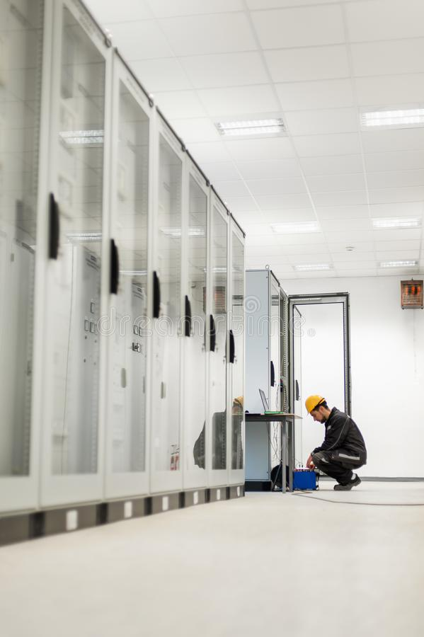 Maintenance engineer inspect system with relay test set equipment. Relay and protection testing stock images