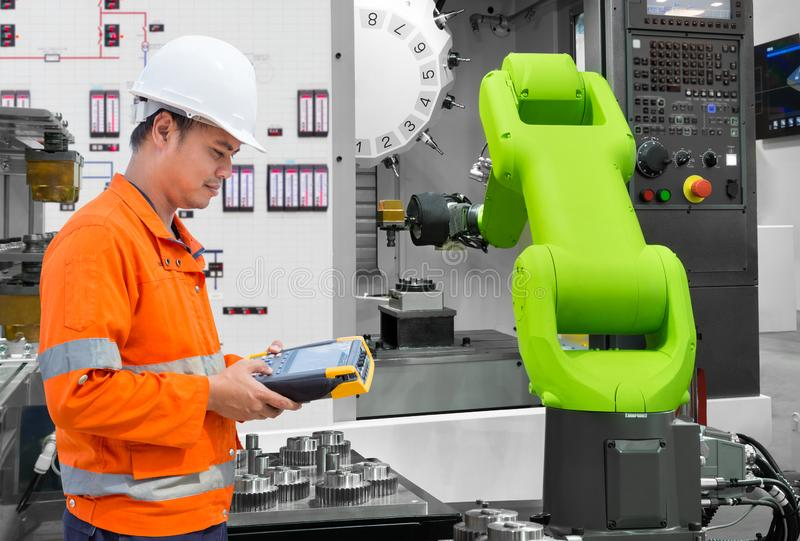 Maintenance engineer testing automatic robotic hand machine tool with CNC machine in automotive industry, Industry 4.0 concept stock photography