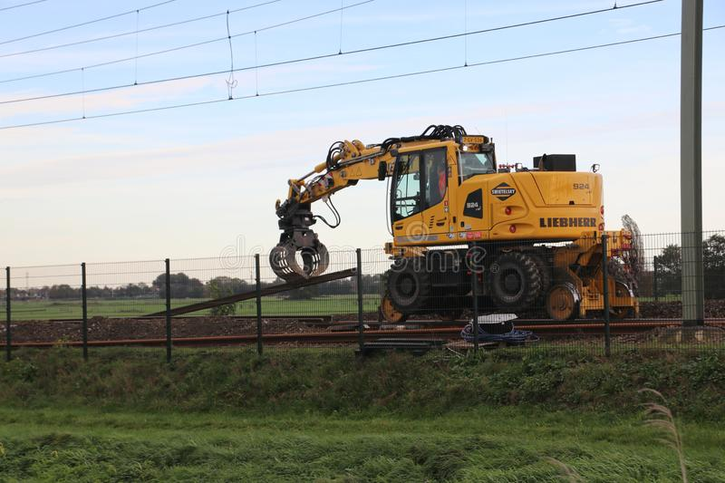 Maintenance on the railroadtracks between Gouda and Rotterdam at Nieuwerkerk aan den IJssel stock images