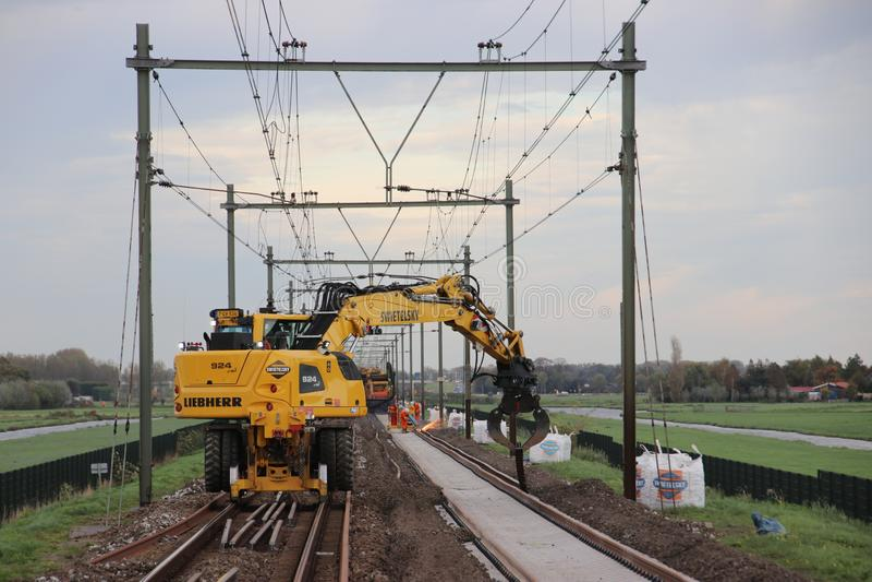Maintenance on the railroadtracks between Gouda and Rotterdam at Nieuwerkerk aan den IJssel royalty free stock photos