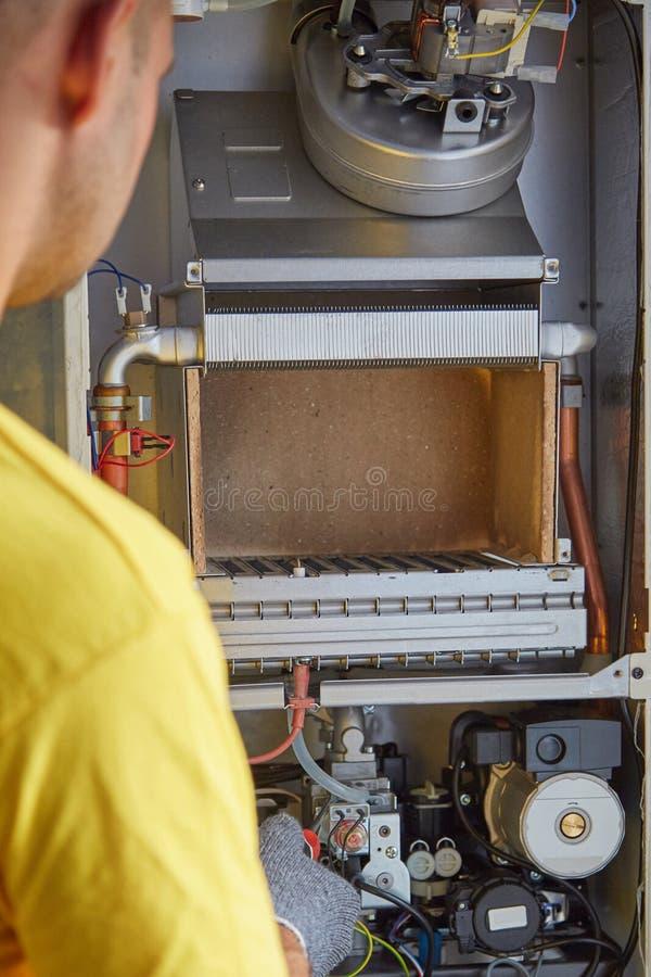 Maintenance, repair, adjustment, gas heater, master service. Maintenance, repair, adjustment gas heater master service stock photography