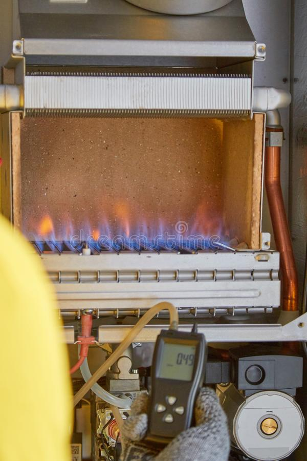 Maintenance, repair, adjustment, gas heater, master service. Maintenance, repair, adjustment gas heater master service stock photo