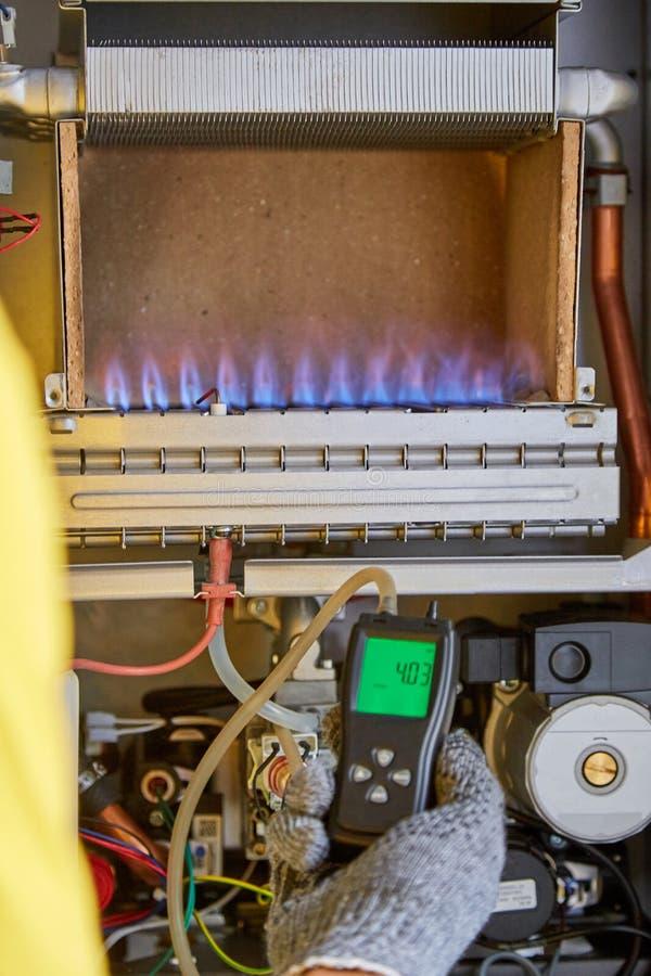 Maintenance, repair, adjustment, gas heater, master service. Maintenance, repair, adjustment gas heater master service stock photos