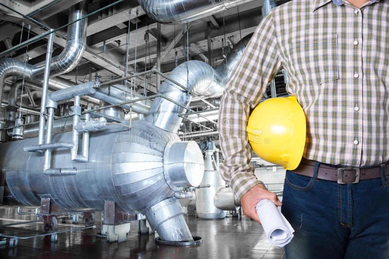 Maintenance technician inside thermal power plant factory.  stock image