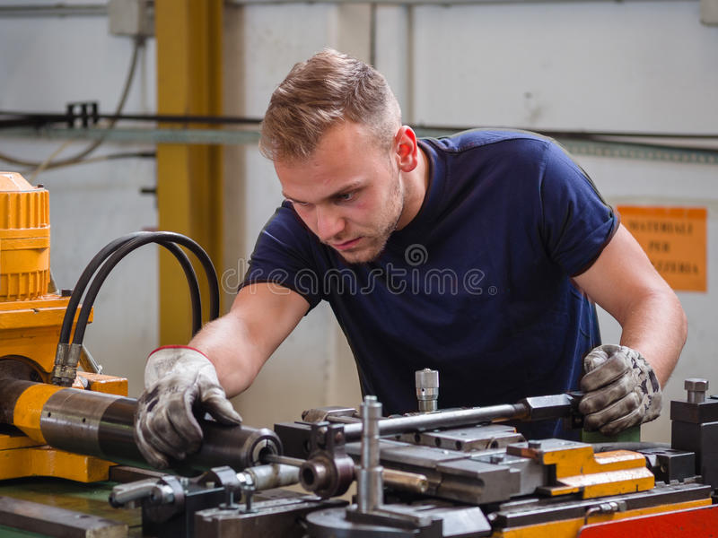 Maintenance work on a bending machine in a workshop. royalty free stock image
