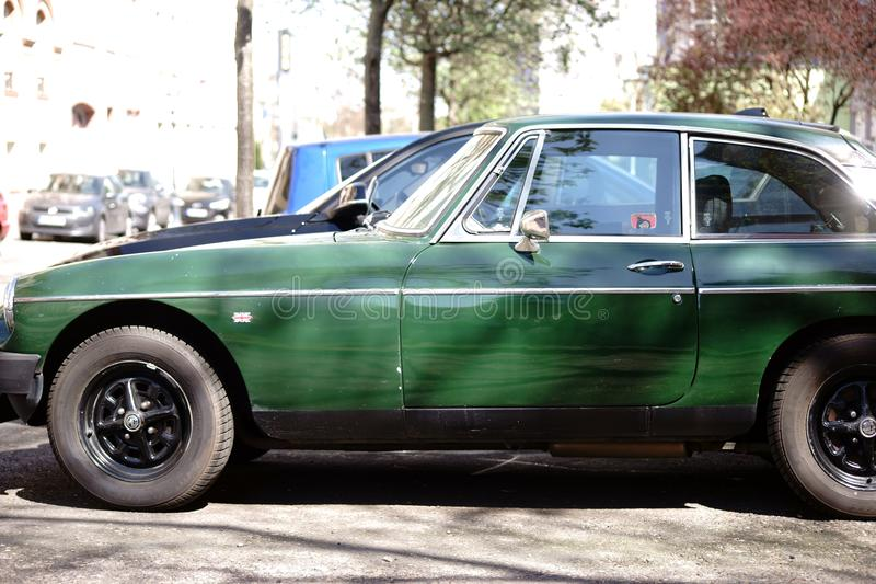 MG Roadster side profile. Mainz, Germany - April 19, 2017: The side profile of a dark green MG Roadster sports car and classic car on April 19, 2018 in Mainz stock photography