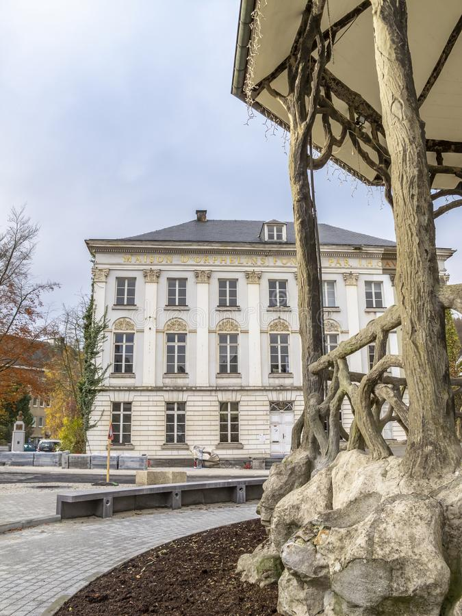 Maison Cavens behind a music pavilion at Place de Rome in Malmedy, Belgium. Maison Cavens in the background, part of a music pavilion at Place de Rome in Malmedy royalty free stock photography