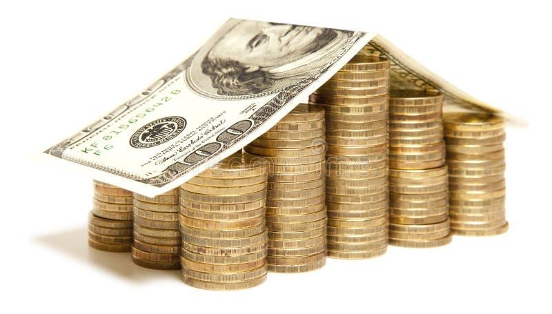 Maison d'argent avec la pièce de monnaie images stock