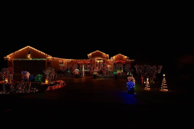 Maison de lumières de Joyeux Noël images stock
