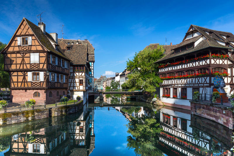 Maison des Tanneurs tanners house, Strasbourg, France. STRASBOURG, FRANCE, AUGUST 06 2016. View of embankment of the Ill river in Petite France district with royalty free stock image